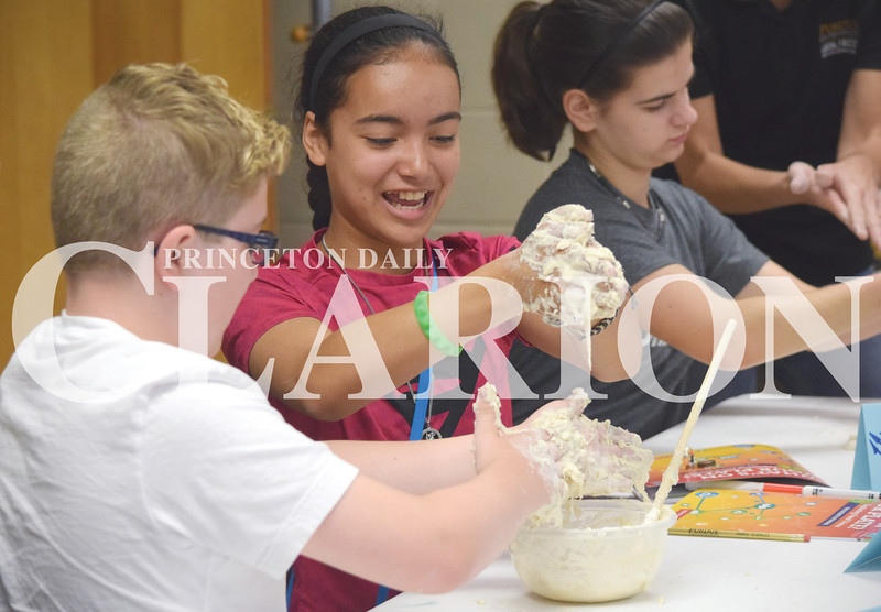 Quiche Matchen/ Daily Clarion<br /> Ethan Hoover, 13, and Evie Silva, 12, laugh as they try to make dough into a ball Tuesday morning at the Gibson County Purdue Extension Office. Tuesday was the first day of the week long Gibson County 4-H food science frenzy where youth will make candy, pretzels, muffins, candy, cheese and other foods.