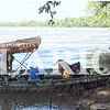 "Daily Clarion/Andrea Howe<br /> Bill Knowles steadies the front of the jonboat for Keith Poole as Poole's companion ""Paint,"" who made the entire river trek with him, waits to explore the Indiana bank south of Crawleyville."
