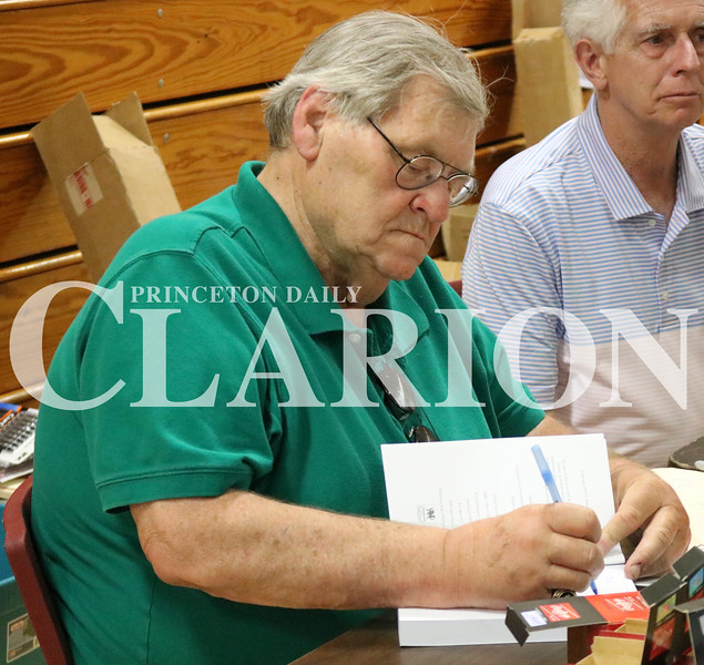 Lucas Whitten/Daily Clarion<br /> <br /> Denny McLain signs a book at Fort Branch Community School on Saturday during a fundraiser for both Princeton and Ft. Branch Softball.