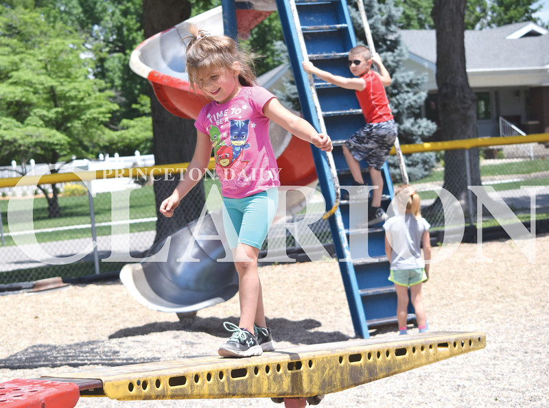 Quiche Matchen/ Daily Clarion<br /> Maddi Falls, 4, walks across the balance beam at the Lions Kiddie Land Park in Princeton Wednesday afternoon. Journi Falls, 5, and Bently Ray, 7, watch her before they slide down the slide.