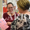 Rachel Graber Akpotu/Daily Clarion <br /> LifeSkills teacher Sara Reynolds reads a handmade birthday card given to her by student Nicole Heichelbech Monday during class at Princeton Community High School.