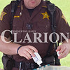Daily Clarion/Andrea Howe<br /> Gibson County Sheriff's Office deputy Tyler Martin empties a bottle into a bin of discarded medications that the department collects from the public for proper disposal during the Gibson County Solid Waste Management District's disposal event at Toyota.