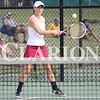 Lucas Whitten/Daily Clarion<br /> Katie Scott smacks a forehand in doubles action on Tuesday at Evansville North High School in a regional semifinal contest against Castle.