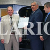 Daily Clarion/Haley Church<br /> Jim WIlderman accepts a 100 years of continuous service award from Chrysler representative Greg Rush, surrounded by J Wilderman Autoplex staff in Mount Carmel Thursday.