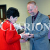 Daily Clarion/Andrea Howe<br /> Clara Mae Welp accepts a commemorative gift marking her 30 years of service as a board member for Arc of Gibson County. Arc of Gibson County Executive Director Stan Keepes presents the award and others during the organization's annual dinner meeting at Princeton Community Middle School cafeteria Monday night