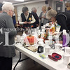 Daily Clarion/Kayla Kinsall<br /> Patrons at the Gibson County Council on Aging card party and silent auction place bids at the auction Friday. The event is one of the organization's largest fundraisers.