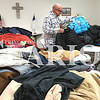 Daily Clarion/Andrea Howe<br /> Patoka United Methodist Church Pastor Jeff Pinney sorts through the 200-plus coats available for the church's first Coat A Community drive planned from 9-11 a.m. Saturday in the church's Family Life Center. All coats are free for the taking, ranging in size from infants to adults. Anyone who wants to donate clean coats in good condition can still do so by contacting the church up to Friday evening, phone 812-779-3693. Patoka UMC is located at 104 N.E. Mill Street in Patoka.