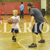 Quiche Matchen/ Daily Clarion<br /> Taylor Mellor works with his son Drake, 7, on basketball skills at the Gibson County Youth Center Tuesday evening. The youth center is open from 3-6 p.m. Monday through Thursday.
