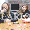 "Quiche Matchen/ Daily Clarion<br /> Sarah Meyer, 13, and Caylee Boling, 15, chat and enjoy snacks before watching ""Pirates of the Caribbean: Dead Men Tell No Tales"" at the Princeton Public Library Friday night."