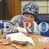 "Quiche Matchen/ Daily Clarion<br /> Nick Adams, 12, enjoys candy and popcorn at the Princeton Public Library's youth lock-in Friday night. The group of attendees watched ""Pirates of the Caribbean: Dead Men Tell No Tales"" and enjoyed pizza later."
