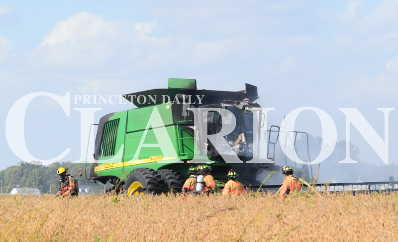 Jake Bethel / Daily Clarion <br /> Fort Branch Fire Department personnel were on the scene of a fire involving a combine and bean field off County Road 400 South Saturday.