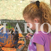 Quiche Matchen/ Daily Clarion<br /> Kaprice Tooley, 6, paints a pumpkin at Lyles Station's annual corn maze Saturday afternoon. Hours for the corn maze are from 5-8 p.m. Friday, 1-8 p.m. Saturday and 1-5 p.m. Sunday through October.