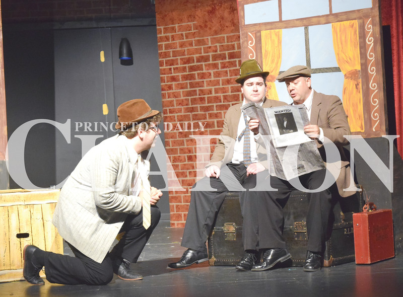"""Quiche Matchen/ Daily Clarion<br /> Tyler Wood who plays Richard Hannay in """"The 39 Steps"""" ducks down to avoid train passengers (Koby Koberstein and Kris Schmidt) noticing that he is the wanted man on the front of the newspaper. The play features four actors who play more than 100 different characters."""