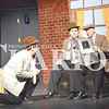 "Quiche Matchen/ Daily Clarion<br /> Tyler Wood who plays Richard Hannay in ""The 39 Steps"" ducks down to avoid train passengers (Koby Koberstein and Kris Schmidt) noticing that he is the wanted man on the front of the newspaper. The play features four actors who play more than 100 different characters."