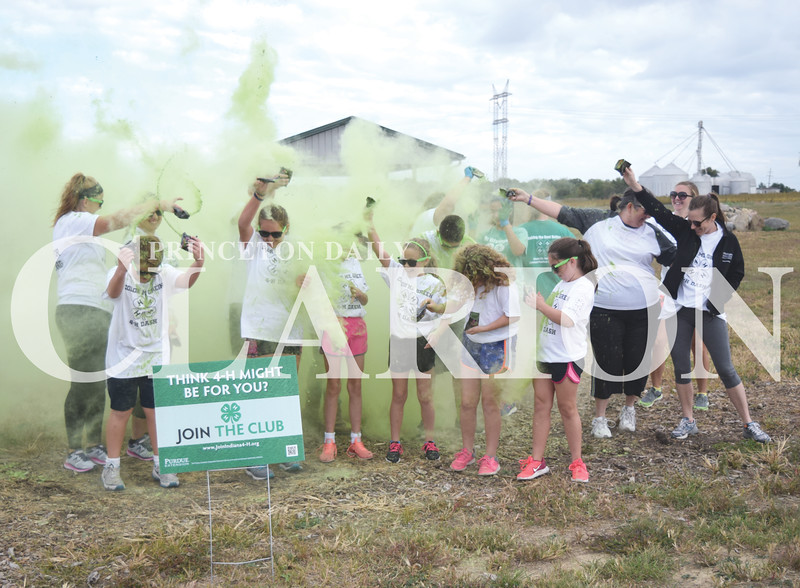 Quiche Matchen/ Daily Clarion<br /> Around 20 Gibson County 4-H  members throw green color run powder in the air at the fourth annual 4-H Color Me Green Dash Saturday morning at Hopkins Family Park in Francisco. All proceeds will go towards 4-H trips, activities and scholarships.