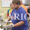 Quiche Matchen/ Daily Clarion<br /> Ethan Muncy fixes a guest's plate with sliced turkey, noodles, mashed potatoes, dressing, green beans, corn, roll, slaw at the dinner Saturday night.