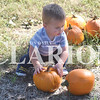 Quiche Matchen/ Daily Clarion<br /> Liam Wonning, 1, picks out a pumpkin in the pumpkin patch at Lyles Station's annual corn maze with his mother Caitlyn. The corn maze includes 10-acres of corn, petting zoo, trackless train, hotdogs, s'mores, and hot apple cider.