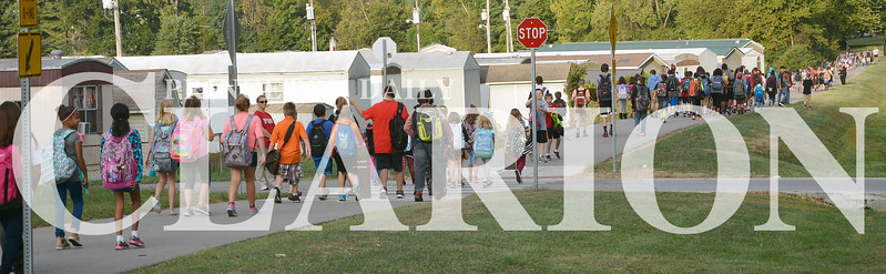 Daily Clarion/Andrea Howe<br /> North Gibson students walk to school Wednesday morning from Lafayette Park, filling the city's walking/biking trails for the National Walk to School Day event.