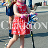 Daily Clarion/Andrea Howe<br /> A little girl make her way along the parade route with her scooter and pony helmet.