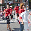 Daily Clarion/Andrea Howe<br /> Princeton Community High School science teacher Jim Maglis flashes the peace sign as the Indiana State Teachers Association unit marches through the Labor Day parade route.