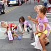 Daily Clarion/Andrea Howe<br /> Youngsters eagerly catch and scramble for candy at Monday's 131st Labor Day Celebration parade on Main Street in Princeton.