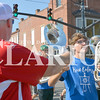 Daily Clarion/Andrea Howe<br /> A Marching Tiger baritone player gets a bottle of cold water along the parade route Monday.