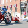 Daily Clarion/Andrea Howe<br /> John Feutz tows precious cargo with his Farmall in the Labor Day parade.