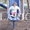 Quiche Matchen/ Daily Clarion <br /> Ahria Childers, 9, laughs as she slides down the slide at the Princeton Community Primary School North playground Thursday evening.