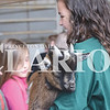 Quiche Matchen/ Daily Clarion Emma Robling holds her Pygmy goat for Owensville Community School fourth graders to pet at the 32nd annual Fourth Grade Farm Fair at the Gibson County Fairgrounds.