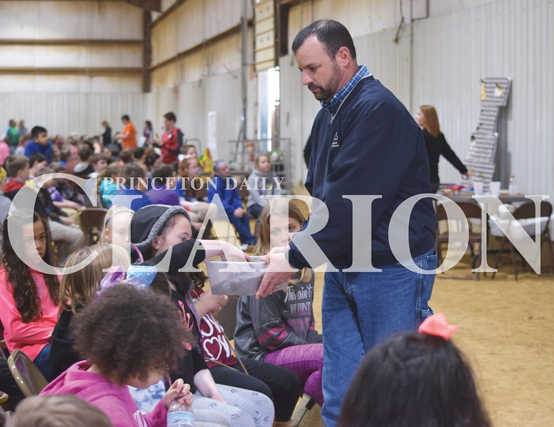 Quiche Matchen/ Daily Clarion <br /> Travis Gogel of Natural Resources Conservation Services let fourth grade students touch sand and explains how important soil is. There were more than 400 students and adults present for the annual Fourth Grade Farm Fair at the Gibson County Fairgrounds.