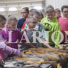 Quiche Matchen/ Daily Clarion <br /> Fort Branch Community School students pet animal fur at the 32nd annual Fourth Grade Farm Fair at the Gibson County Fairgrounds. Julie Loehr, Patoka River Watershed coordinator, talks to students about different animal furs like fox, muskrat, mink and other animals Tuesday morning.