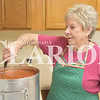 Quiche Matchen/ Daily Clarion <br /> Patoka United Methodist Church's 23rd annual dinner and auction is Saturday at the church's family life center. Church member Patty Craig stirs a pot of vegetable soup for the dinner.