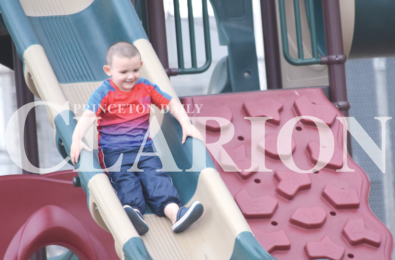 Quiche Matchen/ Daily Clarion <br /> Phoenix Smith, 4, slides down the slide Wednesday afternoon at Lafayette Park. His babysitter said he would go to the park everyday if he could.