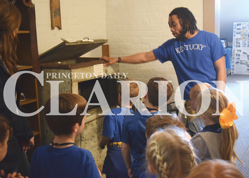 Quiche Matchen/ Daily Clarion <br /> DeAnthony Jamerson talks to St. James Catholic School students about what life was like before electricity at Lyles Station Historic School and Museum Friday afternoon.