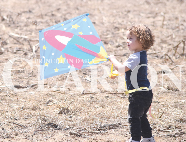 Quiche Matchen/ Daily Clarion <br /> Bryan Scisney III, 2, catches his kite at Lyles Station's Kite Day Saturday afternoon. There were kites for sale and many brought their own kites to fly.