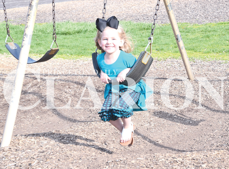 Quiche Matchen/ Daily Clarion <br /> Kennah Reed, 3, smiles while she swings backwards on the Princeton Community Primary School North playground Thursday evening.