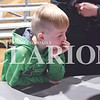 Quiche Matchen/ Daily Clarion <br /> Thomas Davis, 8, watches intensely as someone applies a tourniquet Tuesday evening at the Gibson County Fairgrounds Pavilion.