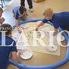 Quiche Matchen/ Daily Clarion <br /> Lucas Schmitt, Cayden Kite, Hogan Merkley and Ben Hughes, all St. James Catholic School second graders, play with marbles at the work and play field trip Friday afternoon at Lyles Station Historic School and Museum.