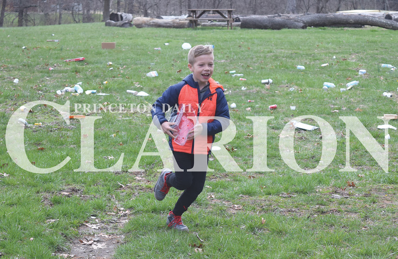 Quiche Matchen/ Daily Clarion <br /> Haubstadt Community School student Jeter Simmons, 9, runs in the recycling relay at the 18th annual Toyota Earth Camp. Students learned how to tell the difference between trash and recycling.