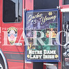Quiche Matchen/ Daily Clarion <br /> A poster on the Princeton Fire Territory fire truck displays pictures of Jackie Young, during Young's celebratory parade.