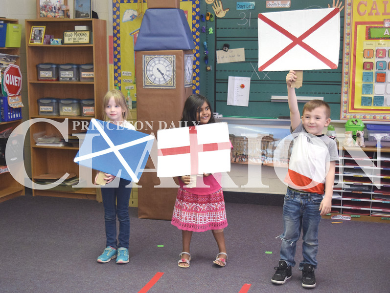 Quiche Matchen/ Daily Clarion <br /> Princeton Community Primary School South students Rebecca Johnson, Anna Beadle and Maddyx Welch hold up United Kingdom flags to welcome guests to the UK. Both PCPS schools hosted a World's Fair and will continue on Friday.