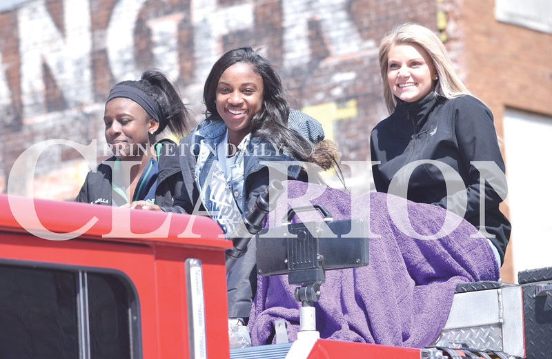Quiche Matchen/ Daily Clarion <br /> Kiare Young, Jackie Young, and Madison Pflug wave and smile at parade attendees on top of a Princeton Fire Territory fire truck, during a parade to honor Young, a National Collegiate Athletic Association Champion. They threw candy to parade attendees and circled the courthouse square a couple of times.