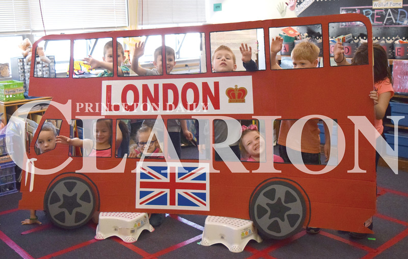"Quiche Matchen/ Daily Clarion <br /> Princeton Community Primary School South students wave from the London bus while singing the ""Wheels on the Bus."""
