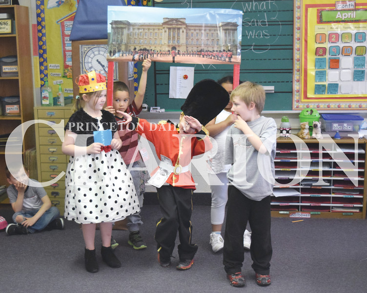 Quiche Matchen/ Daily Clarion <br /> Alexa Minnis (Queen Elizabeth II) watches as her guard Daniel Horken hits a dance move, the dab, while Lucas Denbo laughs. Princeton Community Primary School students presented different places around the world to guests Thursday and continue on Friday.