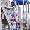Quiche Matchen/ Daily Clarion <br /> Ashlyn Reed, 8, climbs up the rock wall at the Princeton Community Primary School North playground Thursday evening.