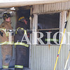 Quiche Matchen/ Daily Clarion <br /> Princeton Fire Territory firefighters work to extinguish a mobile home on the 3000th block of West Sycamore Street, Princeton Saturday afternoon.