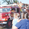 Quiche Matchen/ Daily Clarion  <br /> The Wood Memorial softball team throws candy to parade attendees, during the Oakland City Sweet Corn Festival Parade Thursday evening.