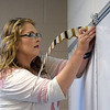 Quiche Matchen/ Daily Clarion  <br /> Kaitlyn Watkins, the new resource teacher at Princeton Community High School, gets her classroom ready for Wednesday, Aug. 8. the first day of school. The 2014 PCHS graduate said she's exited and nervous about her first teaching job.