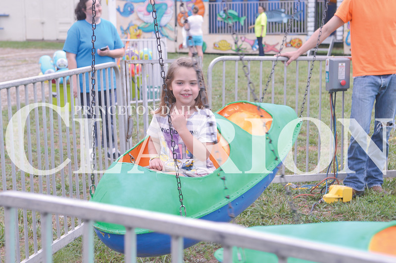 Quiche Matchen/Daily Clarion archive<br /> Loralei Hoskins, 5, of Pike County  enjoys the airplane ride at the Oakland City Sweet Corn Festival.