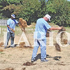 Quiche Matchen/Daily Clarion archive<br /> Gibson County Habitat for Humanity, Toyota Motor Manufacturing Indiana Inc and other volunteers laid hay at a Habitat home for Gibson County United Way's Day of Caring.  Shane Bonaparte and Chuck Sternberg share a few laughs as they laid hay.